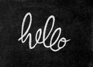 "blackboard with the text that says ""hello"" in handwritten calligraphy"